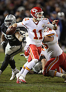 Kansas City Chiefs quarterback Alex Smith (11) scrambles and throws a fourth quarter pass during the NFL week 12 regular season football game against the Oakland Raiders on Thursday, Nov. 20, 2014 in Oakland, Calif. The Raiders won their first game of the season 24-20. ©Paul Anthony Spinelli