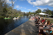 Visitors relax along the Wekiva River at Wekiva Island as canoeists row past, Monday, Jan. 16, 2017, in Longwood, Fla. (Phelan M. Ebenhack via AP)