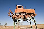 Mongolia. village with communist monument , tractor, on the road to LUN    /  village, ambiance communiste , tracteur a la gloire du kolkhoze, sur la route de Lun   Mongolie