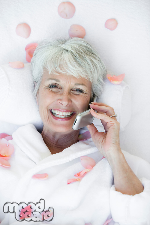 Portrait of senior woman using mobile phone