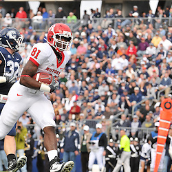 Oct 31, 2009; East Hartford, CT, USA; Rutgers wide receiver Mark Harrison (81) runs for a touchdown after a reception during first half Big East NCAA football action between Rutgers and Connecticut at Rentschler Field.