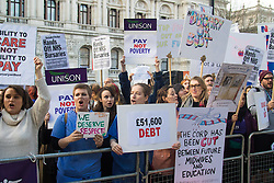 Westminster, London, December 2nd 2015. Student nurses, midwives, occupational therapists, speech and language therapists, podiatrists, radiographers, dietetics and ODPs demonstrate against cuts to NHS bursaries that could saddle these key health workers with years of debt. They claim that with salaries capped at 1% pay rises over the next four years, many are choosing other careers, depriving the UK of these key health professionals.<br />  ///FOR LICENCING CONTACT: paul@pauldaveycreative.co.uk TEL:+44 (0) 7966 016 296 or +44 (0) 20 8969 6875. ©2015 Paul R Davey. All rights reserved.