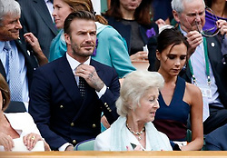 David and Victoria Beckham in the Royal Box on Centre Court during day fourteen of the Wimbledon Championships at the All England Lawn Tennis and Croquet Club, Wimbledon.