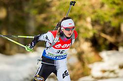 Monika Hojnisz of Poland competes during Women 7.5 km Sprint at day 1 of IBU Biathlon World Cup 2014/2015 Pokljuka, on December 18, 2014 in Rudno polje, Pokljuka, Slovenia. Photo by Vid Ponikvar / Sportida