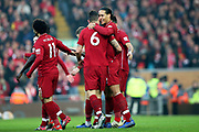Liverpool celebrate Liverpool defender Dejan Lovren (6) goal 1-0 during the Premier League match between Liverpool and Newcastle United at Anfield, Liverpool, England on 26 December 2018.