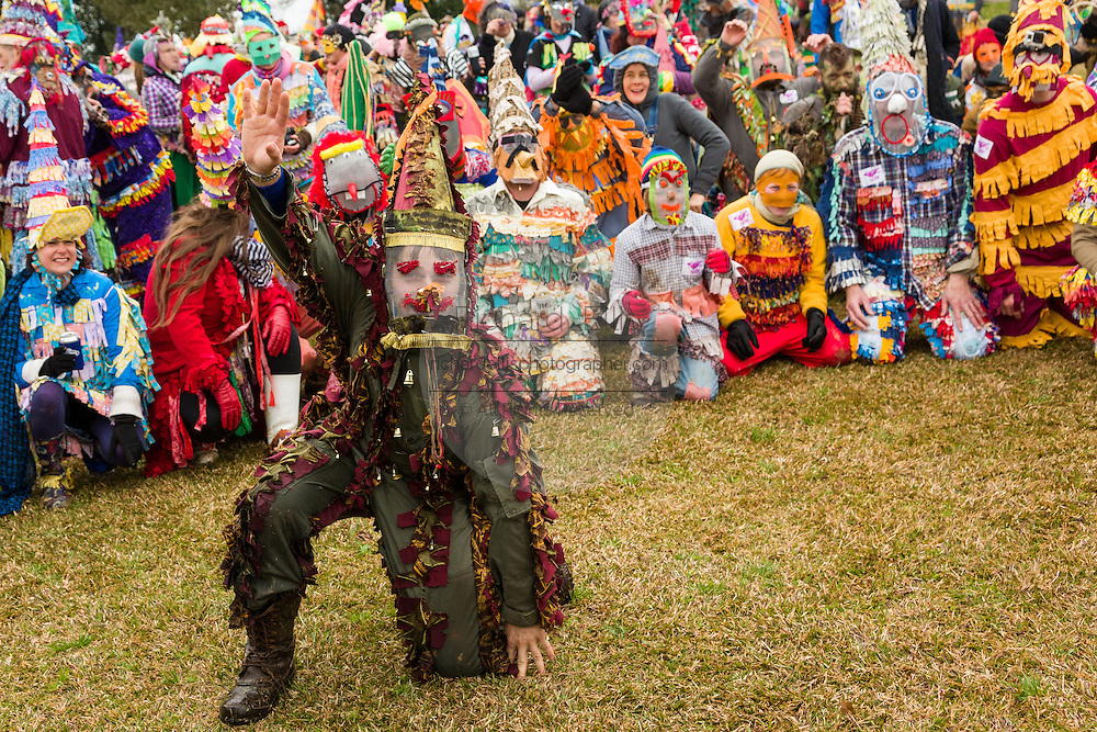 Revelers in traditional costume line up to catch a chicken during the Faquetigue Courir de Mardi Gras chicken run on Fat Tuesday February 17, 2015 in Eunice, Louisiana. The traditional Cajun Mardi Gras involves costumed revelers competing to catch a live chicken as they move from house to house throughout the rural community.