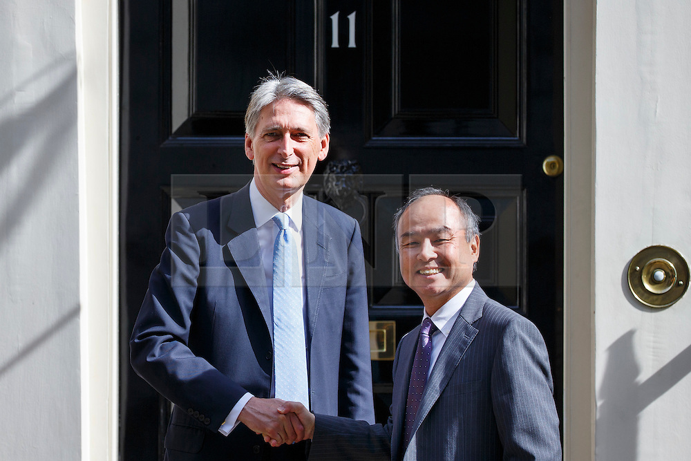 © Licensed to London News Pictures. 18/07/2016. London, UK. Chancellor of Exchequer PHILIP HAMMOND and CEO of SoftBank, MASAYOSHI SON meet at No 11, Downing Street on Monday, 18 July 2016. The UK technology firm ARM Holdings is to be bought by Japan's Softbank for £24bn. Photo credit: Tolga Akmen/LNP