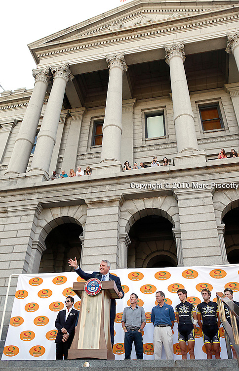 SHOT 8/4/10 10:05:24 AM - Former Tour de France champion Lance Armstrong (center background) and Colorado Governor Bill Ritter (at podium) officially announced plans today for an elite international cycling race to take place in Colorado in 2011 at a press conference on the steps of the state Capitol. The Quiznos Pro Challenge will be the first pro-cycling event in the state since the Coors Classic, which ran from 1979-1988. The Challenge will be held Aug. 22-28, 2011. It will feature a mix of mountain, sprint and downtown stages, and is expected to draw the top cycling teams from around the world. After the press conference Armstrong and Ritter joined an estimated 2,000 cyclists that had attended on a bike ride to Washington Park. (Photo by Marc Piscotty / © 2010)