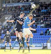 Dundee's Paul McGinn oujumps St Johnstone's Brian Easton - St Johnstone v Dundee, SPFL Premiership at McDiarmid Park<br /> <br />  - &copy; David Young - www.davidyoungphoto.co.uk - email: davidyoungphoto@gmail.com