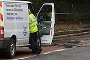 A Thames Water employee at the scene of another burst water pipe, weeks after the disastrous flooding in nearby Herne Hill, Denmark Hill was closed in both directions due to another burst water main in multiple locations across the road (A215) between the junctions of Champion Hill and Champion Park in south London. Water was seen running towards Kings College Hospital, 200 yards downhill and Denmark Hill is a major thoroughfare for the hospital's A+E.