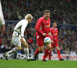 LIVERPOOL, ENGLAND - SUNDAY MARCH 27th 2005: Liverpool Legends' Jan Mølby and Celebrity XI's Nicky Byrne during the Tsunami Soccer Aid match at Anfield. (Pic by David Rawcliffe/Propaganda)