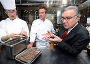 Alain Ducasse (R), chef Jerome Lacressonniere (C) and another unidentified kitchen hand (L) talk in the kitchen of Beige Alain Ducasse Tokyo in the Ginza district of Tokyo, Japan on June 3 2008. .Photographer: Robert Gilhooly.