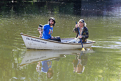 © Licensed to London News Pictures. 20/05/2020. London, UK. Men in a rowing boat on River Lea, Tottenham, north London on a warm and sunny day in London. The government has relaxed the rules on the COVID-19 lockdown, allowing people to spend more time outdoors whilst following social distancing guidelines. According to the Met Office, 27 degrees celsius is forecast for today.  Photo credit: Dinendra Haria/LNP