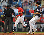 Ole Miss' Tim Ferguson scores on a wild pitch by Auburn's Cole Nelson during the Southeastern Conference tournament at Regions Park in Hoover, Ala. on Friday, May 28, 2010.  (AP Photo/Oxford Eagle, Bruce Newman)