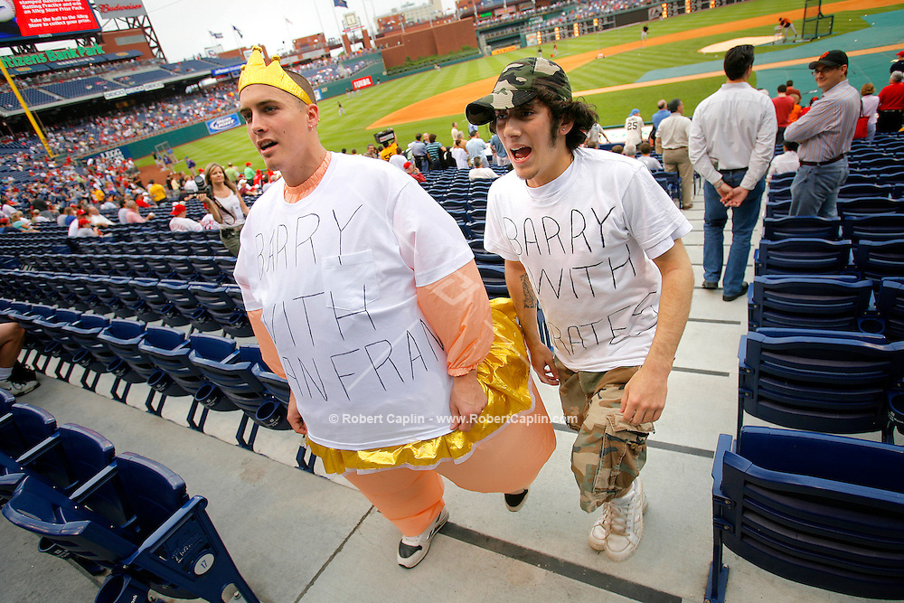 Elizabethtown College classmates, Phil Schaffer, left,  and Mike Assalino, taunt Barry Bonds during batting practice and dress up as Barry Bonds pre-San Francisco Giants and post-San Francisco Giants implying his use of steroids prior to the San Francisco Giants vs Philadelphia Phillies match-up at Citizens Bank Park in Philadelphia May 5, 2006. (Photo by Robert Caplin For The New York Times).