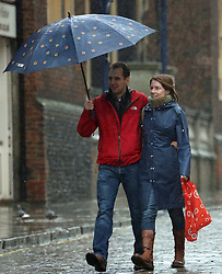 © Licensed to London News Pictures. 01/01/2014. A few brave shoppers braved wind and rain in Guildford, Surrey, on New Year's Day. Credit : Rob Powell/LNP