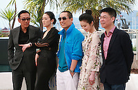 Actor Daoming Chen, actress Li Gong, director Yimou Zhang, actress Huiwen Zhang and producer Zhang Zhao at the photo call for the film Coming Home at the 67th Cannes Film Festival, Tuesday 20th May 2014, Cannes, France.