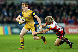 Jack Tovey of Bristol Rugby is tackled by Billy Twelvetrees of Gloucester Rugby - Rogan Thomson/JMP - 03/12/2016 - RUGBY UNION - Kingsholm Stadium - Gloucester, England - Gloucester Rugby v Bristol Rugby - Aviva Premiership.
