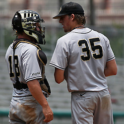 June 04, 2011; Tallahassee, FL, USA; UCF Knights starting pitcher Danny Winkler (35) meets with catcher Beau Taylor (13) during the sixth inning of the Tallahassee regional of the 2011 NCAA baseball tournament against the Bethune-Cookman Wildcats at Dick Howser Stadium. Mandatory Credit: Derick E. Hingle