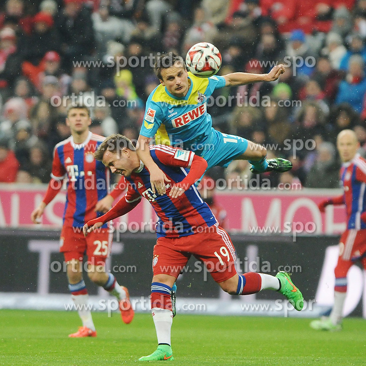 27.02.2015, Allianz Arena, Muenchen, GER, 1. FBL, FC Bayern Muenchen vs 1. FC K&ouml;ln, 23. Runde, im Bild Slawomir Peszko (1.FC Koeln) uebrspringtr Mario Goetze (FC Bayern Muenchen) // during the German Bundesliga 23rd round match between FC Bayern Munich and 1. FC K&ouml;ln at the Allianz Arena in Muenchen, Germany on 2015/02/27. EXPA Pictures &copy; 2015, PhotoCredit: EXPA/ Eibner-Pressefoto/ Stuetzle<br /> <br /> *****ATTENTION - OUT of GER*****
