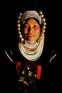 Burma/Myanmar. Portrait of Akha woman wearing a beautiful headdress.