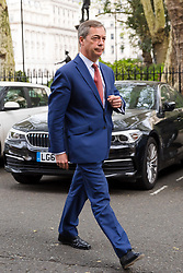 © Licensed to London News Pictures. 23/04/2019. London, UK. Nigel Farage arrives to speak at a Brexit Party candidate launch event in London. Nigel Farage launched his new political party, the Brexit Party earlier this month, to campaign for the European elections. Photo credit: Vickie Flores/LNP
