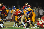 Lafayette High's Tay Tay Owens (3) is hit by Tupelo's Tyler Gilbert (36) in Oxford, Miss. on Friday, August 22, 2014. Tupelo won the season opener 20-0.