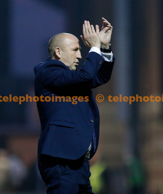 Accrington manager, John Coleman salutes the travelling fans at the end of the Sky Bet League 2 match between Leyton Orient and Accrington Stanley at the Matchroom Stadium in London. October 31, 2015.<br /> Carlton Myrie / Telephoto Images<br /> +44 7967 642437