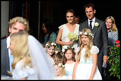 Cara Delevingne watches her sister and her new husband after the service at the wedding of her sister  Poppy Delevingne to James Cook at St.Paul's Church in Knightsbridge, London,  Friday, 16th May 2014. Picture by Andrew / i-Images