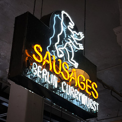 Sign for Berlin Currywurst, of one of the food vendors in the Grand Central Market located in downtown Los Angeles. The market, which opened in 1917, is home to food and drink vendors.