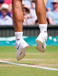 LONDON, ENGLAND - Monday, July 9, 2018: The RF branded Nike shoes of Roger Federer (SUI) during the Gentlemen's Singles 4th Round match on day seven of the Wimbledon Lawn Tennis Championships at the All England Lawn Tennis and Croquet Club. (Pic by Kirsten Holst/Propaganda)
