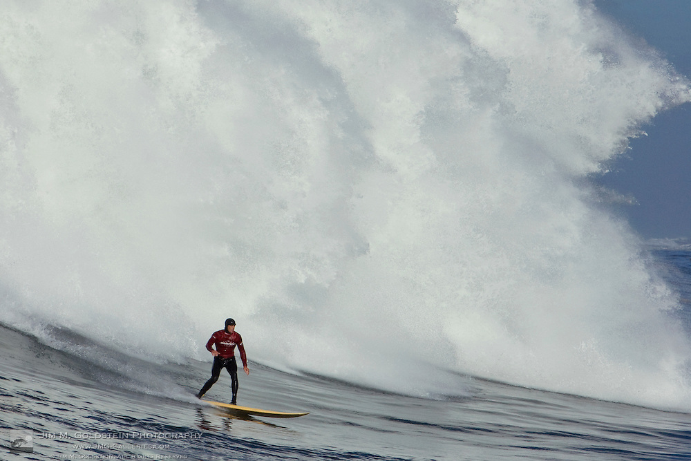 Danilo Couto surfs evading a mountain of white water during Heat 2 at the 2008 Mavericks Surf Contest on January 12 2008