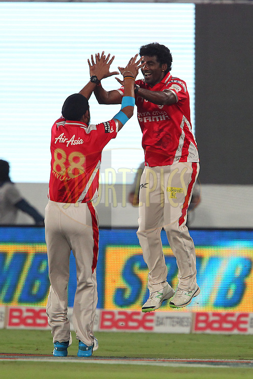 Parvinder AWANA  of the Kings XI Punjab and Anureet SINGH of the Kings XI Punjab celebrate the wicket of Brendon McCULLUM of the Chennai Superkings  during the second semi final match of the Oppo Champions League Twenty20 between the Kings XI Punjab and the Chennai Superkings held at the Rajiv Gandhi Cricket Stadium, Hyderabad, India on the 2nd October 2014<br /> <br /> Photo by:  Ron Gaunt / Sportzpics/ CLT20<br /> <br /> <br /> Image use is subject to the terms and conditions as laid out by the BCCI/ CLT20.  The terms and conditions can be downloaded here:<br /> <br /> http://sportzpics.photoshelter.com/gallery/CLT20-Image-Terms-and-Conditions-2014/G0000IfNJn535VPU/C0000QhhKadWcjYs