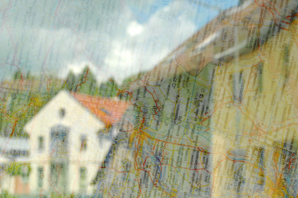 A map of Germany reflected in a windshield. Photo by Daniel Hayduk