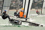 Frrank Lavren (DEN22) rounds the top mark in race seven of the A Class World championships regatta being sailed at Takapuna in Auckland. 15/2/2014