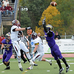 Bloomsburg's Mike Wagner (5) throws a pass, over the head of West Chester's Bob Sabol (2) on a fake field goal attempt, for a touchdown.  This touchdown brought the score to 35-34, and after the extra point, Bloomsburg tied the game. TK4