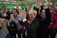 Victorious Labour Party supporters led by Angela Eagle MP cheering candidate Margaret Greenwood as she gives a speech after defeating sitting MP Esther McVey at the count at Bidston Tennis Centre, Wirral for the Wirral West constituency in the 2015 UK General Election. The constituency was held by Esther McVey for the Conservative Party, who won the seat from Labour at the 2010 General Election. The constituency was one of the key marginal seats contested between the two main UK political parties.