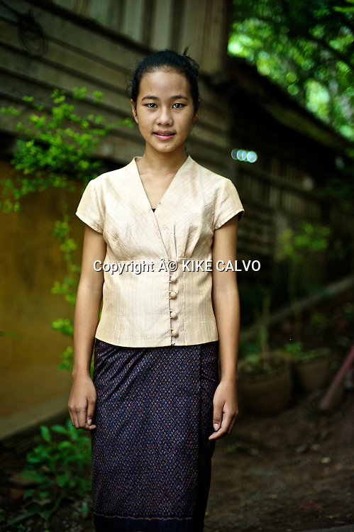 Teen girl wearing a contemporary Lao prime silk formal attire. Best silk comes from Vientiane.