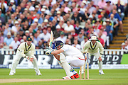 England batsman Jos Buttler ducks a delivery from Mitchell Johnson during the 3rd Investec Ashes Test match between England and Australia at Edgbaston, Birmingham, United Kingdom on 30 July 2015. Photo by Shane Healey.