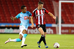 Tom Ince of Derby County chases Jack O'Connell of Sheffield United - Mandatory by-line: Matt McNulty/JMP - 27/07/2016 - FOOTBALL - Bramall Lane - Sheffield, England - Sheffield United v Derby County - Pre-season friendly