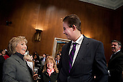 """Senator Barbara Boxer (D-CA) greets Trevor Schaefer, youth ambassador and founder of Trevor's Trek Foundation before an Environment and Public Works Committee during a hearing on """"Oversight Hearing on Disease Clusters and Environmental Health."""""""