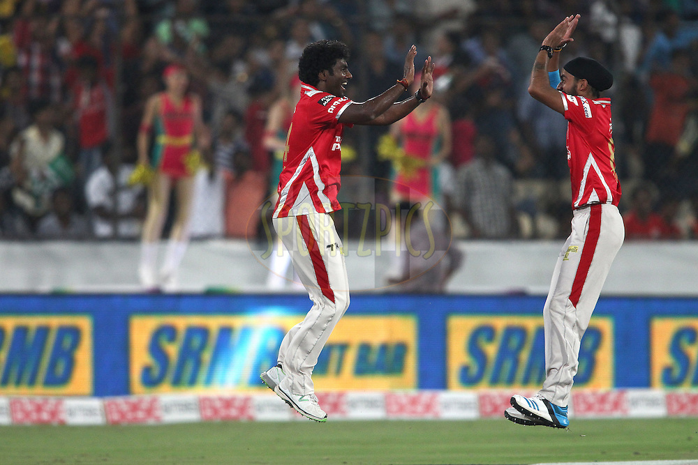 Parvinder Awana of the Kings XI Punjab is congratulated by Anureet Singh of the Kings XI Punjab for taking the catch to get Brendon McCullum of the Chennai Super Kings wicket during the second semi final match of the Oppo Champions League Twenty20 between the Kings XI Punjab and the Chennai Superkings held at the Rajiv Gandhi Cricket Stadium, Hyderabad, India on the 2nd October 2014<br /> <br /> Photo by:  Shaun Roy / Sportzpics/ CLT20<br /> <br /> <br /> Image use is subject to the terms and conditions as laid out by the BCCI/ CLT20.  The terms and conditions can be downloaded here:<br /> <br /> http://sportzpics.photoshelter.com/gallery/CLT20-Image-Terms-and-Conditions-2014/G0000IfNJn535VPU/C0000QhhKadWcjYs