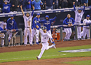 Oct 27, 2015; Kansas City, MO, USA; Kansas City Royals left fielder Alex Gordon (4) reacts after hitting a solo home run to tie the game against the New York Mets in the 9th inning in game one of the 2015 World Series at Kauffman Stadium.