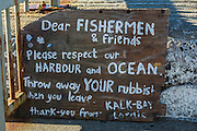 Hand painted sign asking for respect of the Kalk Bay harbour, False Bay, Western Cape, South Africa