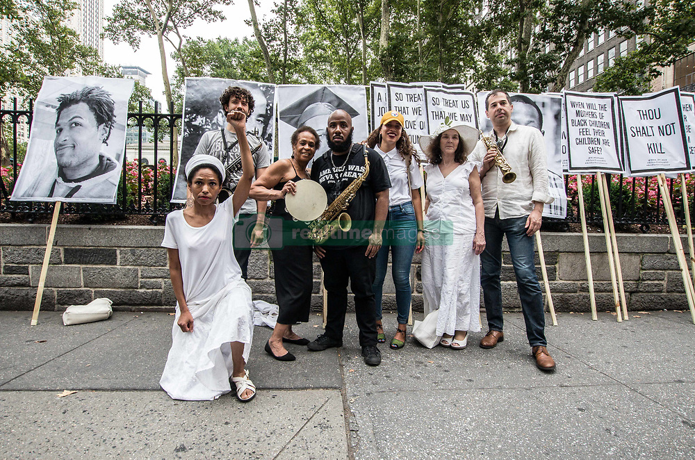 July 28, 2017 - New York, New York, United States - (Photo: Sachelle Babbar)  In protest the policies of the Trump Administration and threats to various communities in America, artists, activists, and community members participated in a solidarity march to bring attention to those marginalized.  The platforms were: respect for lives, economic and social equality, diversity, and freedom of expression.  The participants marched in silence in white attire, in homage to the 1917 Silent Protest Parade.  Kindred Arts was the event organizer.  .The Silent Parade was a silent protest march of 8,000-10,000 African Americans along Fifth Avenue starting at 57th Street in New York City on July 28, 1917. (Credit Image: © Sachelle Babbar via ZUMA Wire)