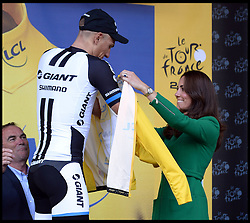 Image ©Licensed to i-Images Picture Agency. 05/07/2014. Yorkshire, United Kingdom. The Duchess of Cambridge presented the coveted yellow jersey to Germany's Marcel Kittel as The Royals attend the Tour De France -Yorkshire. The Duke and Duchess of Cambridge and Prince Harry at  the Stage One finish line at Harrogate. They are watching  the cyclists cross the finish line in an expected sprint finish, before presenting the awards to the Stage One winners. Picture by Andrew Parsons / i-images