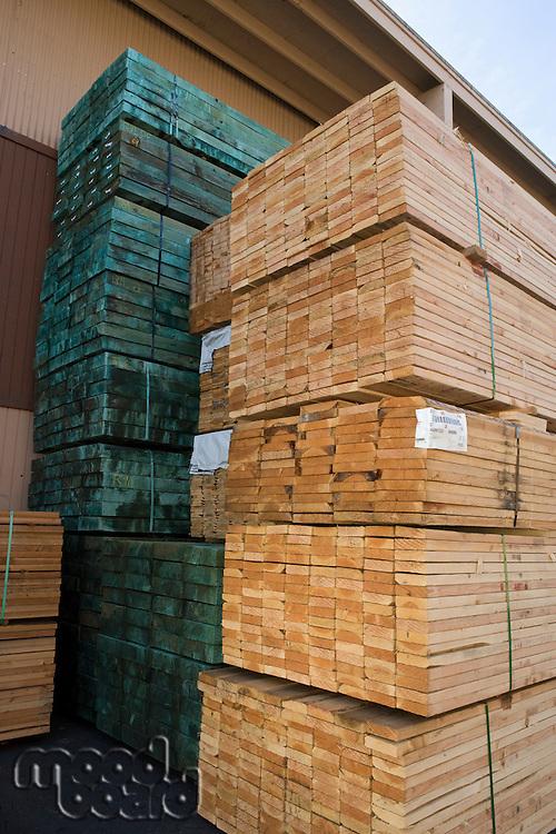 Stacks of wood outside warehouse
