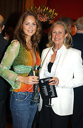 Left to right, JACKIE TURNER and ALDINE HONEY at an aution of art inspired by footballer David Beckham in aid of The National Deaf Children's Society and held at Christie's, St.James's, London on 4th November 2004.<br />