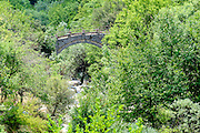 A traditional stone bridge Zagori, Pindus mountains, Epirus, Greece.