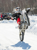 Tyler Sweeney of Lynn, MA pops a wheelie as he heads out onto the plowed track at Lily Pond Saturday morning.  (Karen Bobotas/for the Laconia Daily Sun)